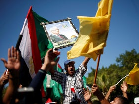Palestinians celebrate after Hamas said it reached a deal with Palestinian rival Fatah, in Gaza City October 12, 2017.