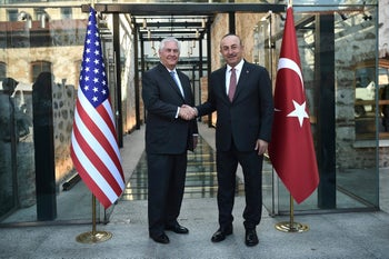 Turkish Foreign Minister, Mevlut Cavusoglu shakes hands with U.S. Secretary of State Rex Tillerson, left, during their meeting in Istanbul, Sunday, July 9, 2017.