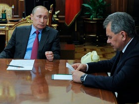 Russian President Vladimir Putin, center, Russian Foreign Minister Sergey Lavrov, left, and Russian Defense Minister Sergey Shoygu, right, speak during their meeting in the Kremlin in Moscow, Russia, Monday, March 14, 2016.