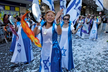 Chinese Christian pilgrims take part in an annual march for Israel in Jerusalem organized by the International Christian Embassy and the Jerusalem municipality. October 10, 2017