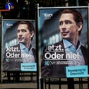 """An election campaign posters of Austrian People's Party (OeVP) top candidate and Foreign Minister Sebastian Kurz are seen in Vienna, Austria, October 5, 2017. Posters read """"Now or never!"""" and """"Movement for Austria""""."""