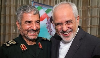 Islamic Revolutionary Guard Corps (IRGC) commander Mohammad Ali Jafari (L) and Iran's Foreign Minister Mohammad Javad Zarif at a coordination meeting for the 40th anniversary of the Islamic Revolution. Tehran, Iran. October 9, 2017