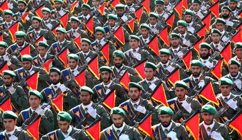 Iran's Revolutionary Guard troops parade to mark the 36th anniversary of Iraq's 1980 invasion of Iran, in front of the shrine of Ayatollah Khomeini, just outside Tehran, Iran. Sept. 21, 2016