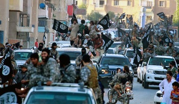 ISIS fighters are seen in Raqqa in this undated file image, posted on June 30, 2014 by a Syrian opposition group
