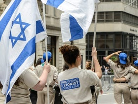 """A participant wears a shirt that reads """"This is what a Zionist looks like"""" while participating in the """"Celebrate Israel"""" parade in New York City, June 4, 2017."""