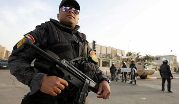 File photo: A member of the special police forces stand guard in Cairo, Egypt.