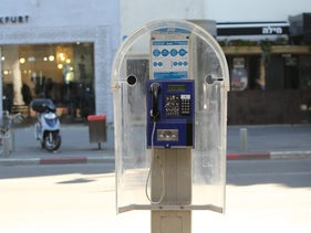 A public telephone in Tel Aviv installed and operated by Israeli company Bezeq in 2016.