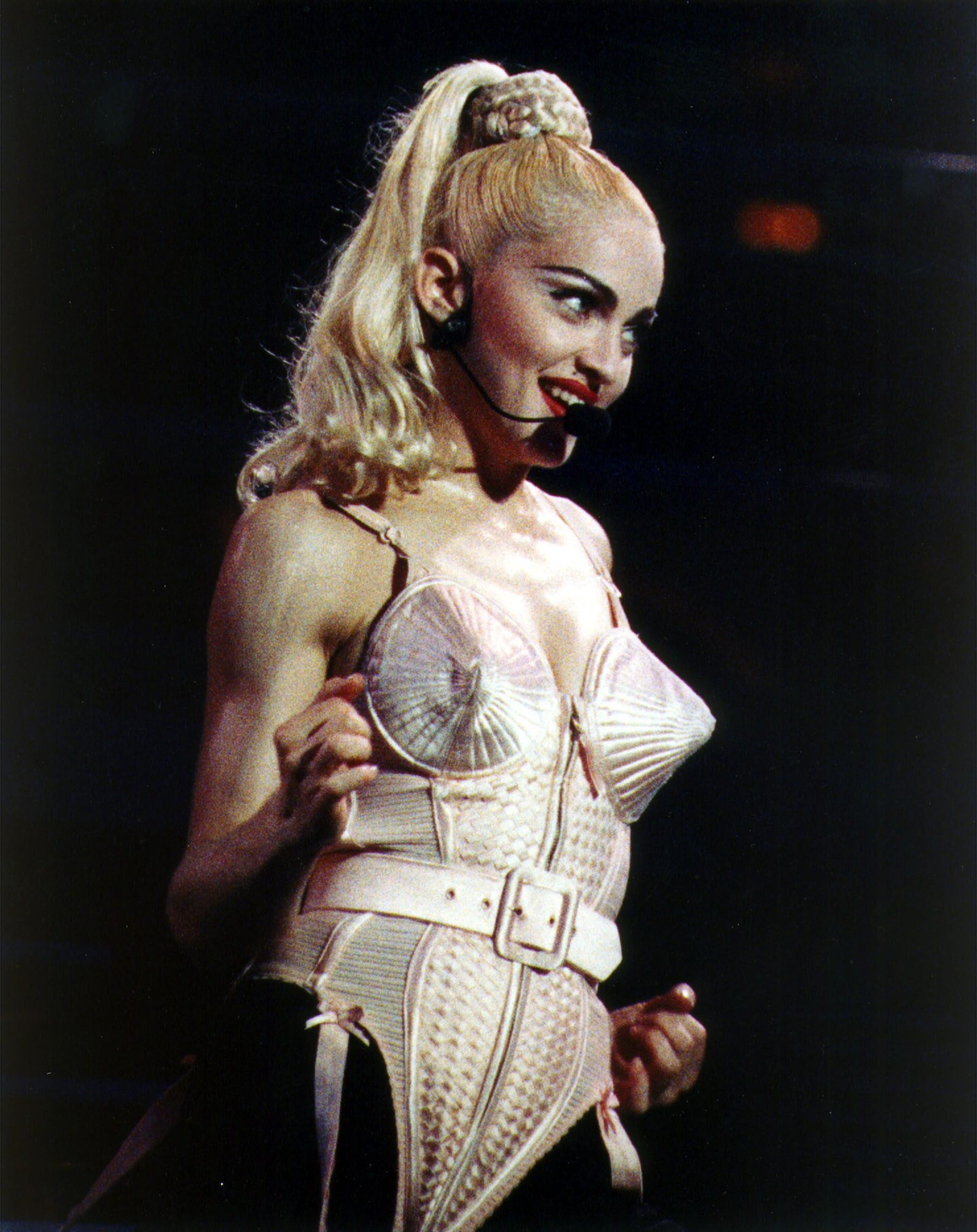 Madonna wearing the cone-shaped corset designed by Jean Paul Gaultier, in 1990.