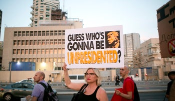 Anti-Trump protesters hold a rally near the U.S. embassy in Tel Aviv during Trump's visit to Israel, May 2017.