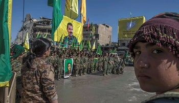 In this Thursday, Oct. 19, 2017 photo, fighters from the Women's Protection Units, or YPJ, hold a celebration in Paradise Square in Raqqa, Syria
