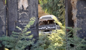 A picture taken on October 20, 2017, shows a bus belonging to the Islamic State group police in the recently seized strategic Syrian town of Mayadeen.