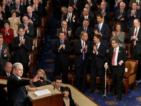 """Israeli Prime Minister Benjamin Netanyahu speaks before a joint meeting of Congress on Capitol Hill in Washington, Tuesday, March 3, 2015. In a speech that stirred political intrigue in two countries, Netanyahu told Congress that negotiations underway between Iran and the U.S. would """"all but guarantee"""" that Tehran will get nuclear weapons, a step that the world must avoid at all costs."""