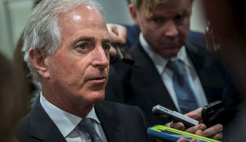 Sen. Bob Corker (R-TN) talks to reporters as he heads to a vote on amendments to the fiscal year 2018 budget resolution, on Capitol Hill, October 19, 2017