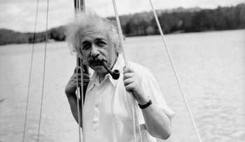 Albert Einstein leans against the mast of his boat at Saranac Lake, N.Y., July 3, 1936.