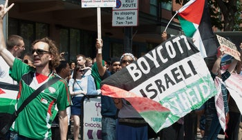 Pro-Palestinian activists protest in London on August 2, 2014, calling for a boycott against Israel.