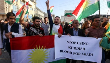 Iraqi Kurds take part in a demonstration outside the US consulate in Erbil, the capital of autonomous Iraqi Kurdistan, on October 21, 2017, to protest against the escalating crisis with Baghdad.