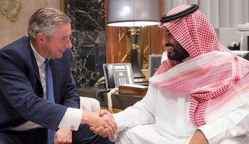 Saudi Crown Prince Mohammed bin Salman and Klaus Kleinfeld shaking hands following the Crown Prince's appointment of Kleinfeld as NEOM's Chief Executive Officer, in Riyadh, October 24, 2017