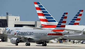 In this Wednesday, May 27, 2015, file photo, an American Airlines jet taxis to the gate at Miami International Airport, in Miami