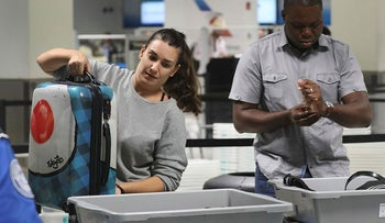 Travelers use the automated screening lanes funded by American Airlines and installed by the Transportation Security Administration at Miami International Airport on October 24, 2017 in Miami, Florida