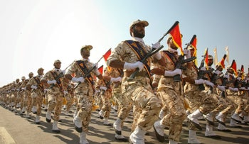 Members of the Iranian Revolutionary Guard march in Tehran September 22, 2011