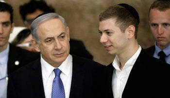 Israeli Prime Minister Benjamin Netanyahu and his son Yair on March 18, 2015.