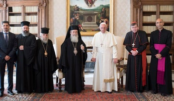 Pope Francis poses with Greek Orthodox Patriarch of Jerusalem Theophilos III (4th R), and members of the delegation, during a private audience at the Vatican October 23, 2017.