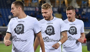 Lazio's players wear shirts with a picture of Anne Frank and the words 'No to anti-Semitism' before their match against Bologna in Bologna, Italy, October 25, 2017.