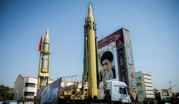 A display featuring missiles and a portrait of Iran's Supreme Leader Ayatollah Ali Khamenei is seen at Baharestan Square in Tehran, Iran September 27, 2017.