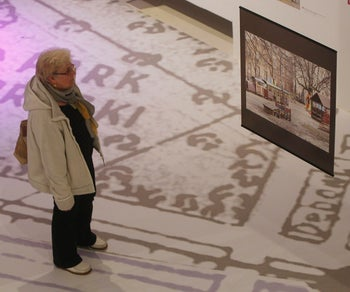 A visitor to the Museum of the History of Polish Jews looks at an image of a site that used to be part of the Jewish district in pre-World War II Warsaw, Warsaw, Poland, March 27, 2014.