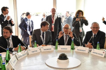 Officials from media companies and EU representatives attend a G7 session on Ischia island, Italy, October 20, 2017.