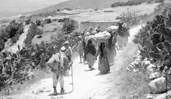 A picture released on September 15, 1948 shows Palestinian refugees returning to their village after its surrender during the Arab war against the proclamation of the State of Israel.