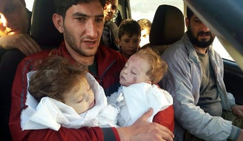 Abdel Hameed Alyousef, 29, holds his twin babies who were killed during a suspected chemical weapons attack, Khan Sheikhoun, Idlib, Syria, April 4, 2017.