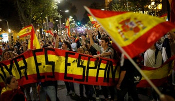 Protesters march against the declaration of independence approved by the Catalan parliament, Barcelona, Spain, October 27, 2017.