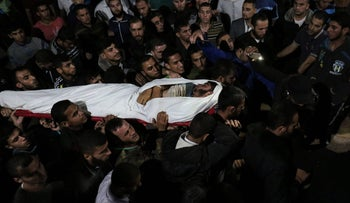 A body carried by mourners after he was killed when Israel blew up a cross-border tunnel, Gaza Strip, October 30, 2017.