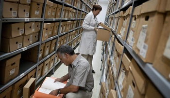 Employees search for documents at the Israel State Archives in Jerusalem, Israel.