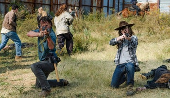 This image released by AMC shows Andrew Lincoln as Rick Grimes, left, and Chandler Riggs as Carl Grimesֲ in a scene from, 'The Walking Dead.'