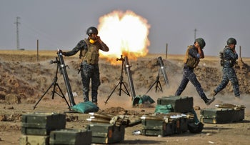 Members of the Iraqi forces fire mortars against Kurdish Peshmerga positions at Fish-Khabur, near the Turkish and Syrian borders in the KRG, Iraq, October 26, 2017.