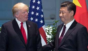 File photo: Donald Trump and Chinese President Xi Jinpint in Hamburg, Germany on July 8, 2017