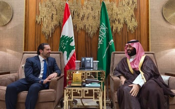 In this photo released October 30, 2017 by a Lebanese government photographer, Prime Minister Saad Hairir meets with Saudi Crown Prince Mohammed bin Salman.