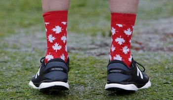An attendee wears Canadian flag themed socks during the Canada Day event on Parliament Hill in Ottawa, Ontario, Canada, on Saturday, July 1, 2017