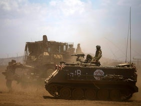 Israeli soldiers drive armored military vehicles during training exercises in the Israeli-occupied Golan Heights, near the border with Syria. June 17, 2015
