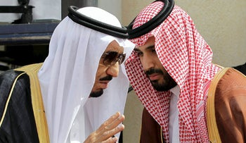 In this May 14, 2012 file photo, King Salman, left, speaks with his son, now Crown Prince Mohammed Bin Salman, (MBS), as they wait for Gulf Arab leaders ahead of the opening of Gulf Cooperation Council, in Riyadh, Saudi Arabia