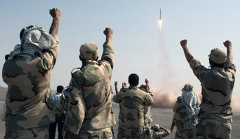File photo: Iran's Revolutionary Guards testing ballistic missiles, 2012.