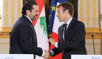 French President Emmanuel Macron (right) shakes hands with Lebanese Prime Minister Saad Hariri during a joint press conference in Paris, September 1, 2017.
