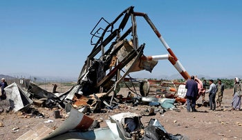 Yemenis check the damage at a navigation station at Sanaa International Airport that was destroyed in Saudi-led air strikes in the Yemeni capital on November 15, 2017