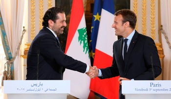 FILE PHOTO- French President Emmanuel Macron (R) shaking hands with Lebanese Prime Minister Saad Hariri during a press conference in Paris on September 1, 2017