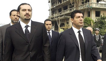 FILE PHOTO- Bahaa Hariri, right, and Saad Hariri visit the scene where their father was assassinated in Beirut, Lebanon on Feb. 19, 2005