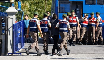 File photo: Turkish forces escort a soldier accused of involvement in the failed 2016 coup, October 2017.