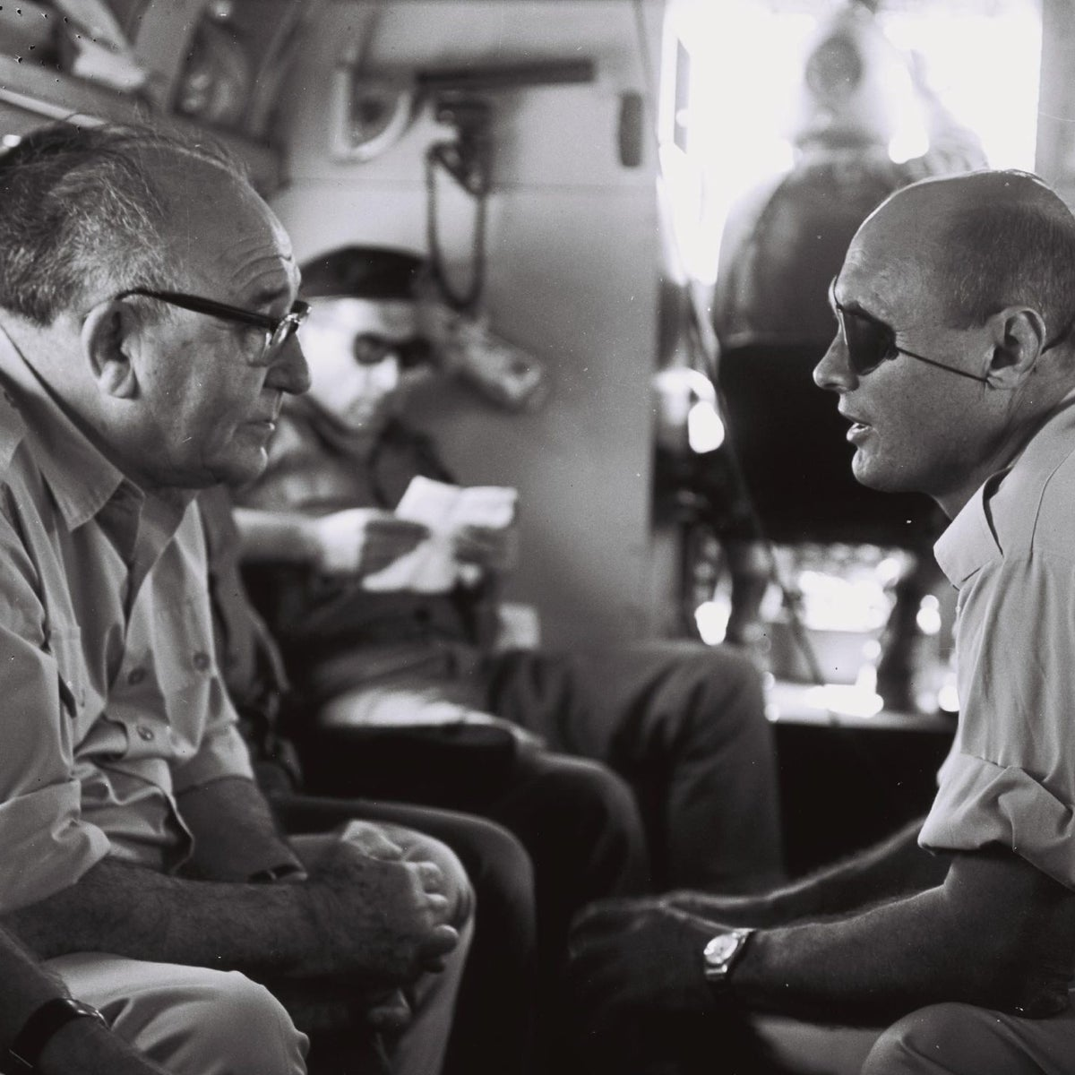 Prime Minister Levi Eshkol and Defense Minister Moshe Dayan fly over the West Bank after the Six-Day War.