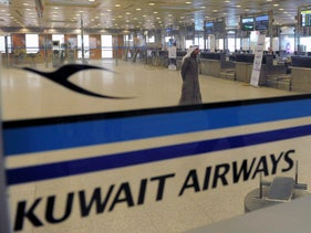 File photo: Kuwait Airways check-in counters at Kuwait Airport, March 18, 2012